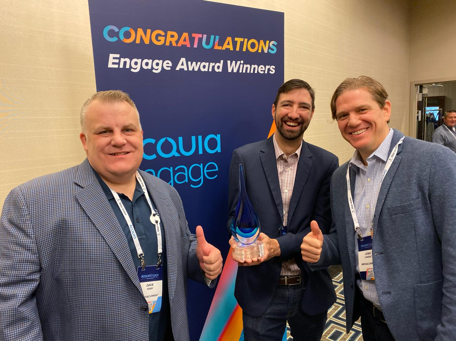 Mediacurrent team holds Acquia Engage Award trophy in 2019
