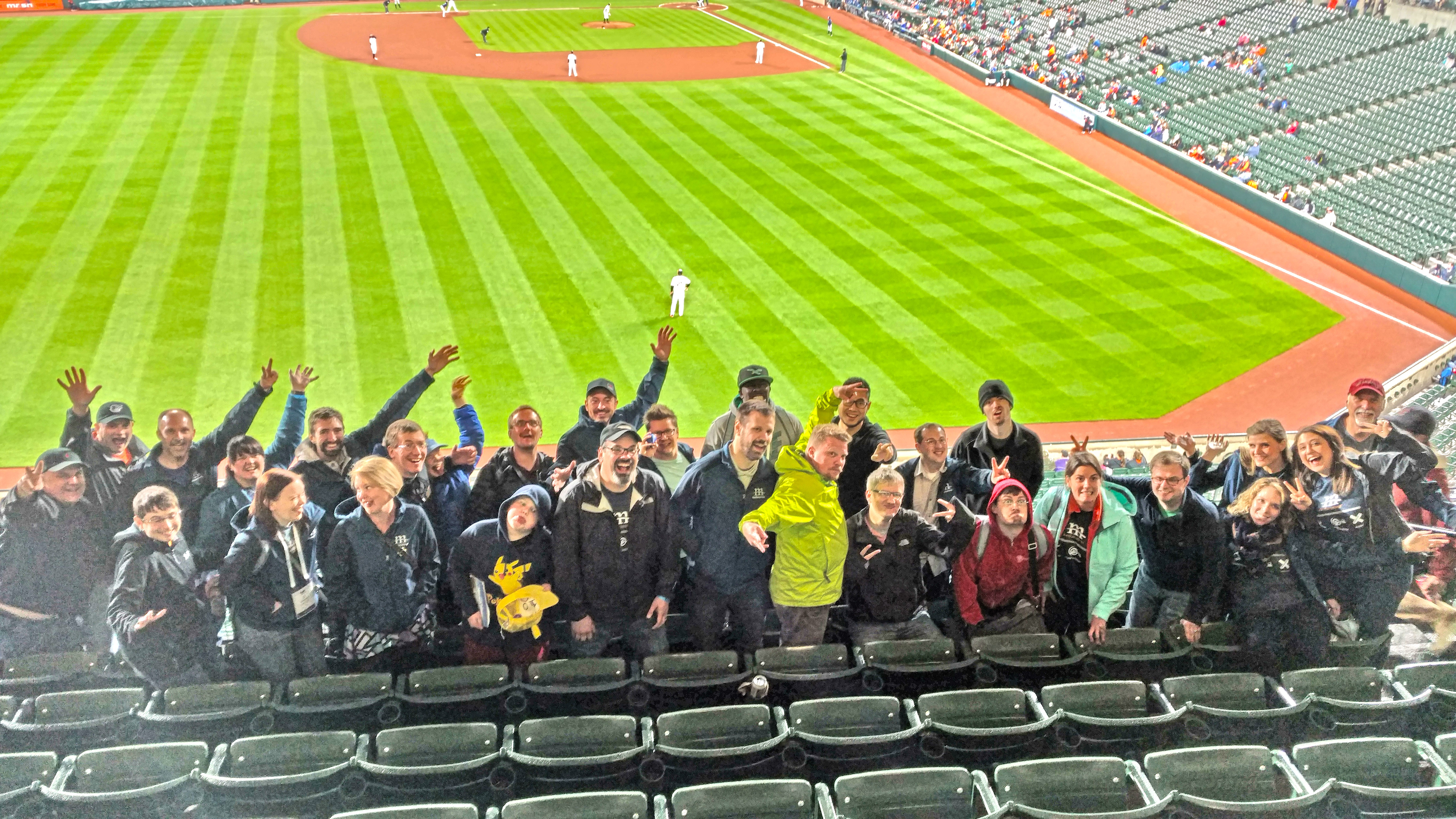 Picture of Mediacurrent team at a Braves game in front of the field