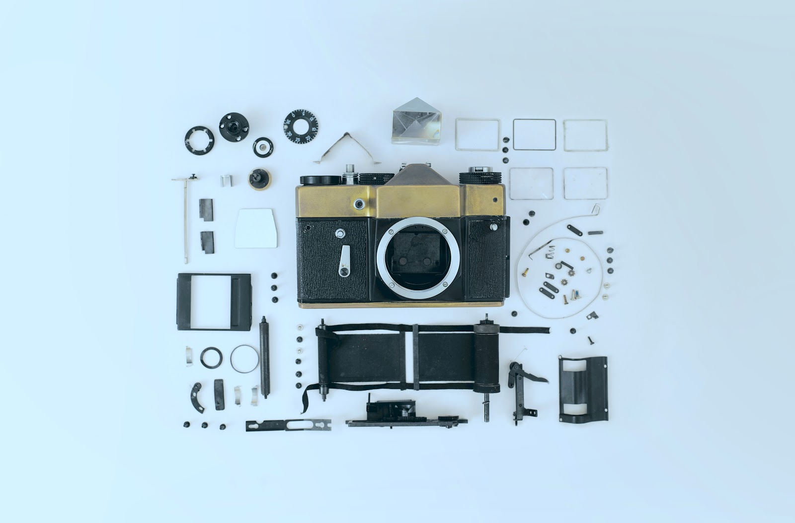 A disassembled single lens reflex camera with all its parts