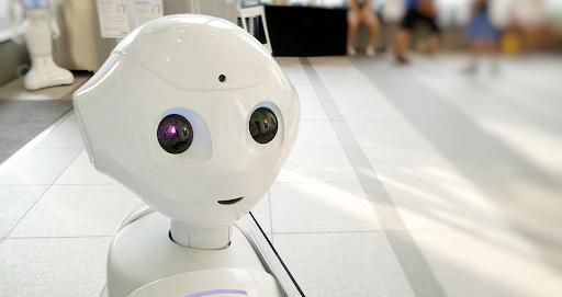 white plastic robot peering over its shoulder