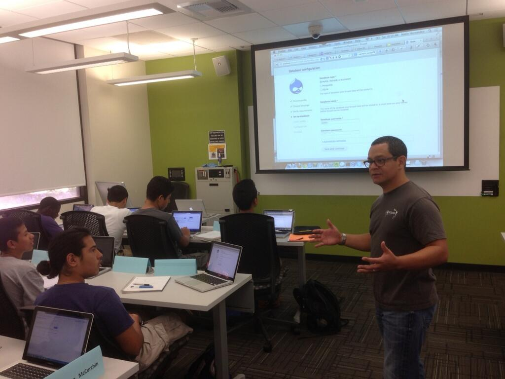 Mario Hernandez teaching the students of TxT, Teens Exploring Technology